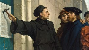 Luther nailing 95 Theses starting Reformation
